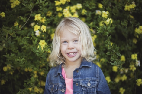 image of little girl with yellow flowers portrait session by jessica michlle photo