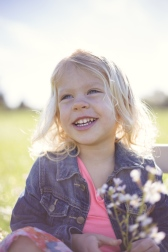 bright image of smiling girl in flower field by jessica michelle photo port jefferson ny