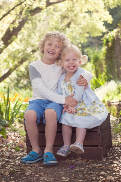 image of brother and sister hugging outdoors during portrait session by jessica michelle photo