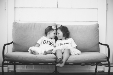image of sibling sisters looking at each other during portrait session by jessica michelle photo
