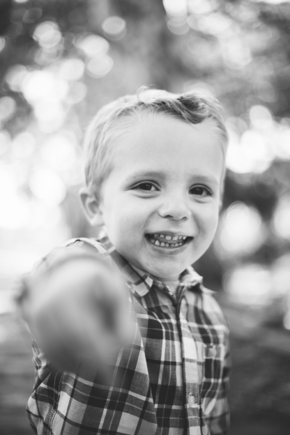 black and white photo of young boy playing during family session by jessica michelle photo