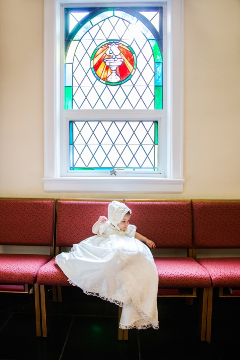 portrait of baby girl in white gown during christining by jessica michelle photo