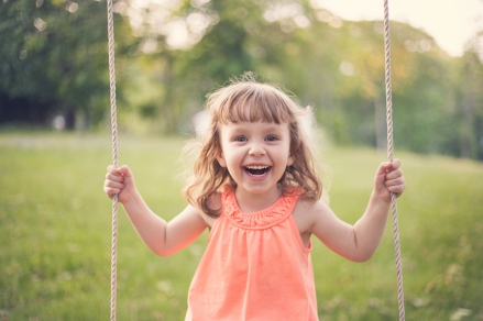 colorful image of young girl on swing during portrait session by jessica michelle photo