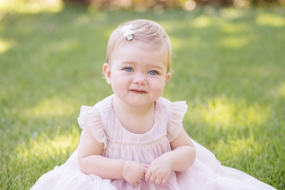 portrait of baby girl in pink gown during portrait session by jessica michelle photo