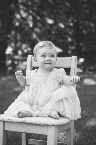 portrait of baby girl on a chair ourdoors during photo session by jessica michelle photo
