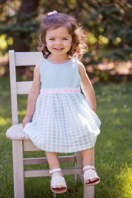 colorful image of young girl on chair during portrait session by jessica michelle photo