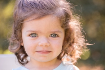 colorful image of young girl with blue eyes during portrait session by jessica michelle photo