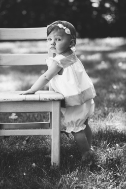 black and white portrait of serious baby girl during portrait session by jessica michelle photo