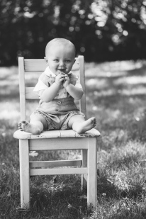 portrait of baby boy on a chair ourdoors during photo session by jessica michelle photo
