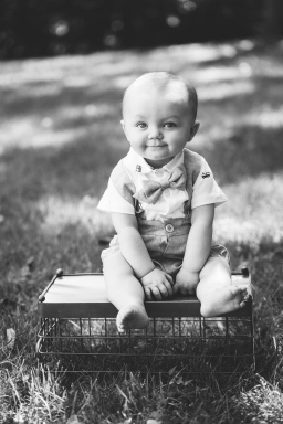 black and white portrait of daper baby boy during portrait session by jessica michelle photo