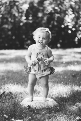 portrait of baby sticking tongue out during portrait session by jessica michelle photo