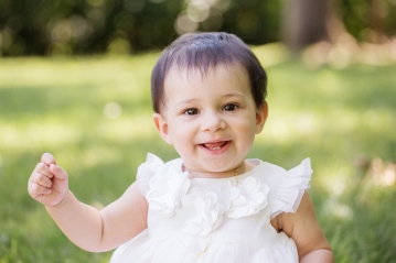 portrait of baby girl in white gown during photo session by jessica michelle photo