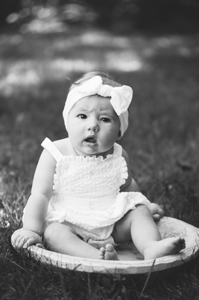 black and white portrait of baby with headband during portrait session by jessica michelle photo