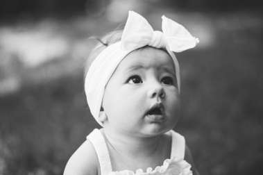 black and white portrait of baby with headband during photo session by jessica michelle photo