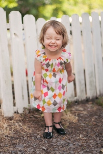 portrait of little girl in bright patterned dress druing photo session by jessica michelle photo