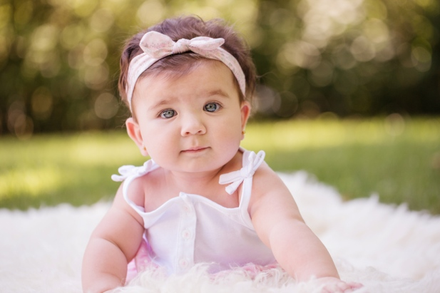 image of baby girl doing tummy time on rug by jessica michlle photo port jefferson