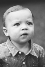 black and white portrait of baby looking up during photo session by jessica michelle photo