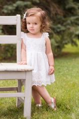 image of little girl by chair during portrait session by jessica michelle photo