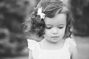 black and white portrait of girl looking down during photo session by jessica michelle photo