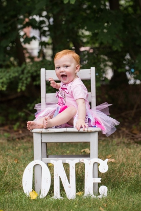 portrait of one year old baby girl on a chair by jessica michelle photo