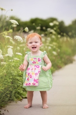 image of baby girl by white flowers during portrait session by jessica michelle photo