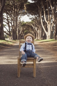 portrait of dapper one year old baby boy on a chair by jessica michelle photo