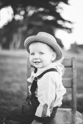 portrait of dapper one year old baby boy with hat by jessica michelle photo
