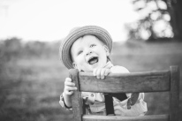 black and white image of one year old boy with hat by jessica michelle photo