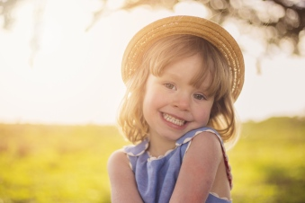 portrait of little girl in hat druing photo session by jessica michelle photo