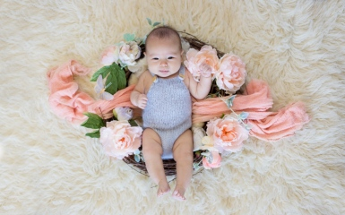 portrait of one hundred day old baby girl during portrait session by jessica michelle photo