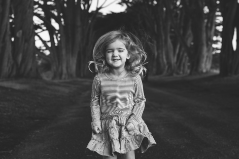 black and white portrait of jumping little girl at family session by jessica michelle photo