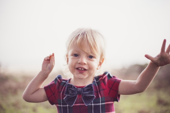 image of blonde little girl playing at family session by jessica michelle photo