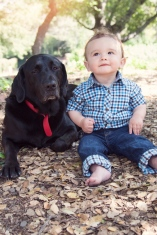 portrait of baby boy with black lab dog by jessica michelle photo