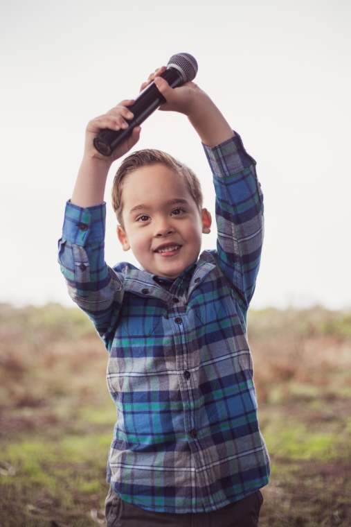 image of young boy playing with microphone during family session by jessica michlle photo