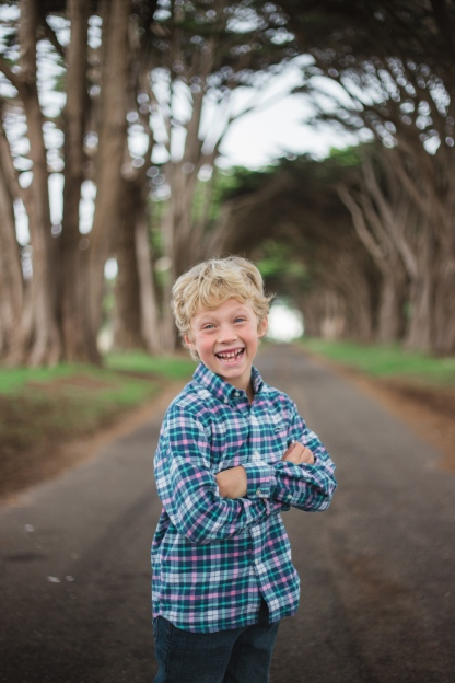 photo of young boy laughing during a family session by jessica michlle photo