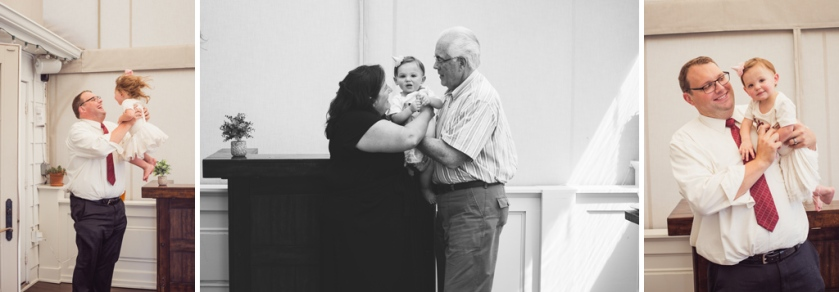 portrait of one year old baby girl with family at birthday party jessica michelle photo
